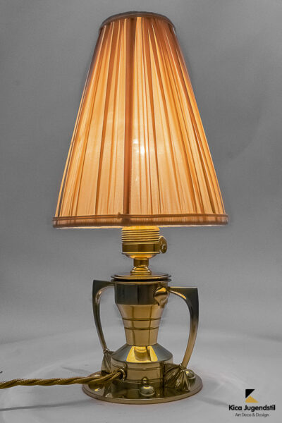 Art Deco table lamp, Vienna, 1920s Polished and stove enameled The shade is replaced (new). Details Dimensions Height: 14.57 in. (37 cm) Diameter: 6.3 in. (16 cm)